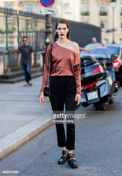 A model wearing a ripped off top outside Ulyana Sergeenko during Paris Fashion Week Haute Couture Fall/Winter 20172018 Day Three on July 4 2017 in...