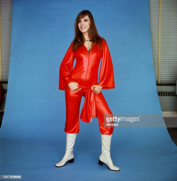 A model wearing a scarlet catsuit in gleaming cire by House of Ailish £9 April 1970