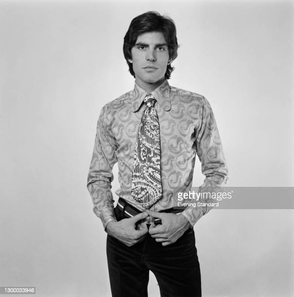 Model wearing a shirt and tie in contrasting patterns, UK, 1st March 1972.