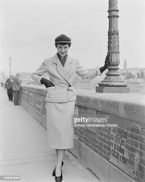 A model wearing a suit and cap beside the River Arno in Florence Italy 21st July 1951
