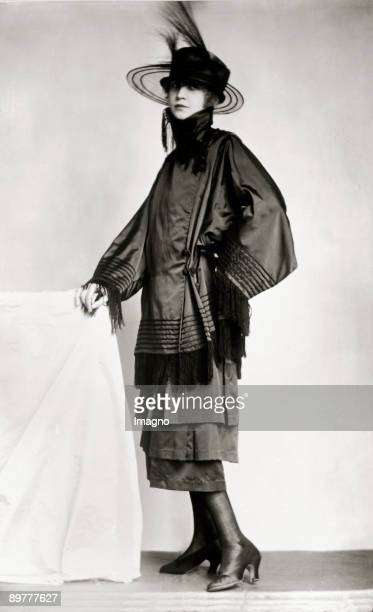 Model wearing a suit designed by Eduard Josef WimmerWisgrill Made by the Wiener Werkstaette Photograph 1919