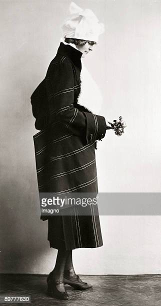 Model wearing a suit designed by Eduard Josef WimmerWisgrill Made by the Wiener Werkstaette Photograph 1920