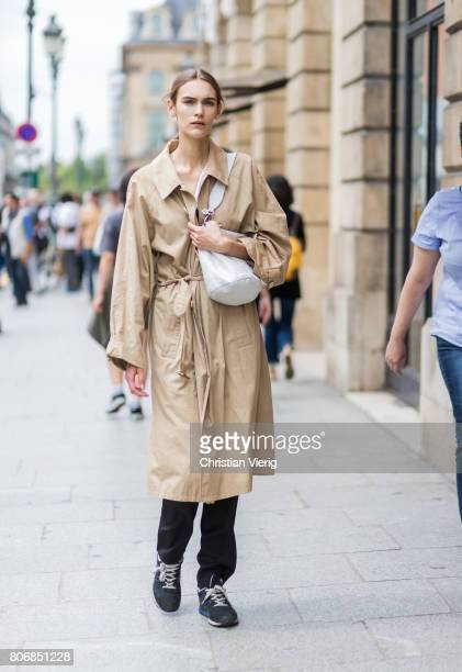 A model wearing a trench coat outside Schiaparelli during Paris Fashion Week Haute Couture Fall/Winter 20172018 Day Two on July 3 2017 in Paris France