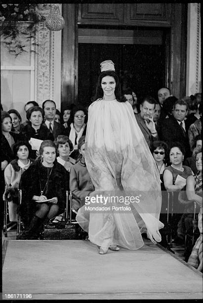 A model wearing a tulle dress catwalking at Palazzo Pitti Florence 1960s