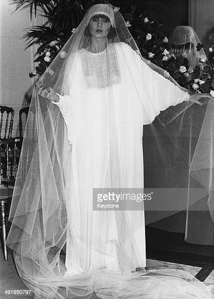 A model wearing a wedding dress by French fashion designer Marc Bohan for the 197677 Christian Dior AutumnWinter collection Paris 27th July 1976