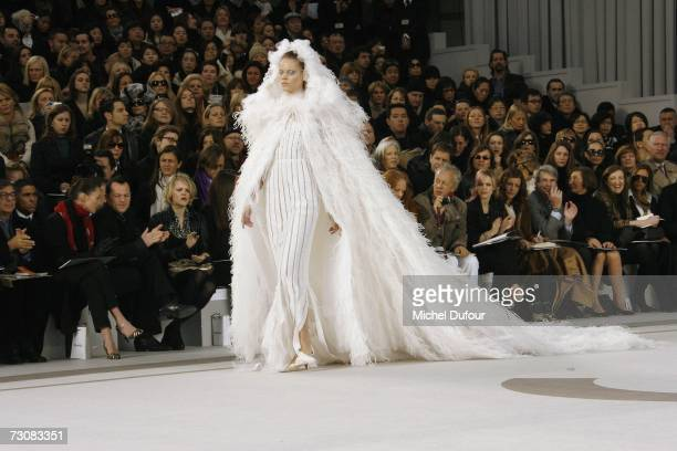 A model wearing a wedding dress walks on the catwalk at the Chanel Fashion show during Paris Fashion Week SpringSummer 2007 at Grand Palais on...