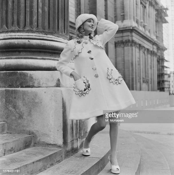 A model wearing a white moufflon coat with satin trimmings by Miss Mouse UK 20th October 1972