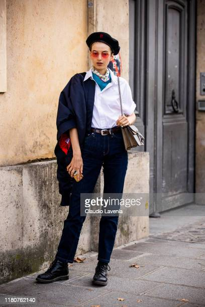Model, wearing a white shirt, blue jeans, blue jacket, Gucci bag and black boots, is seen outside the Beautiful People show during Paris Fashion Week...