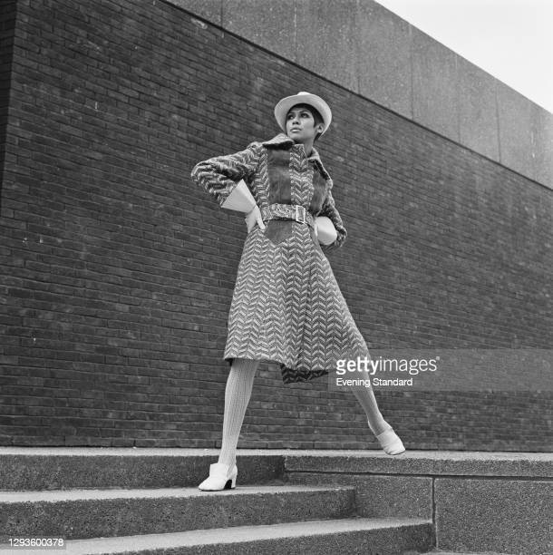 Model wearing a winter coat in blue and beige tweed, with blue suede trimming, at the Royal College of Art degree show in London, UK, 1967.