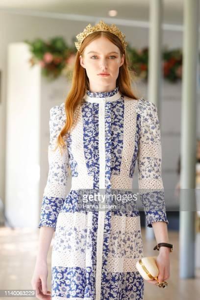 A model wearing an Alexander McQueen blue dress as a nod to Champion winning race horse Winx's jockey silks walks runway during the ATC Autumn...