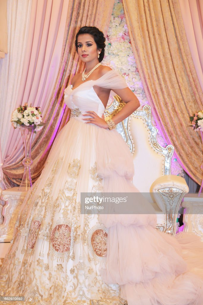 Model wearing an elegant bridal gown during a bridal show in Scarborough, Ontario, Canada.
