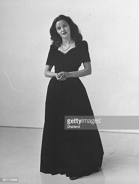 Model wearing an evening dress as part of 'new look' postwar style by designer Edith Head