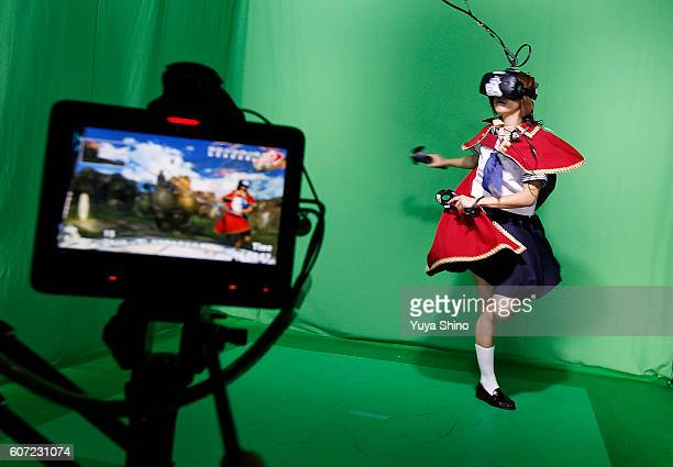 A model wearing an HTC Corp Vive VR headset demonstrates a virtual reality video game in the PD Tokyo booth at Tokyo Game Show on September 17 2016...