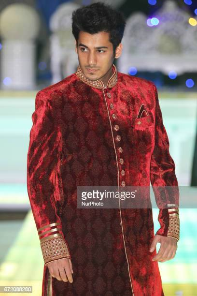 Model wearing an ornate Sherwani suit during the East Meets West Fashion Show held in Mississauga Ontario Canada on April 23 2017 The show featured...