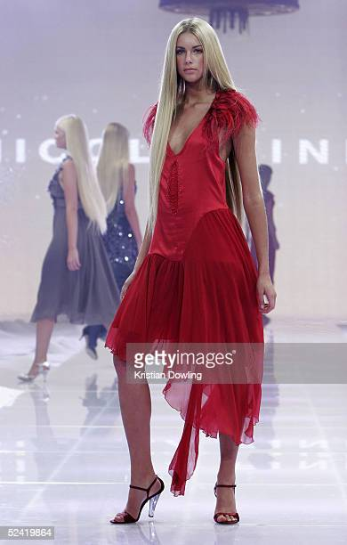 A model wearing an outfit by Nicola Finetti walks down the catwalk during the Myer VIP Parade of Autumn/Winter 05 collection as part of the L'Oreal...