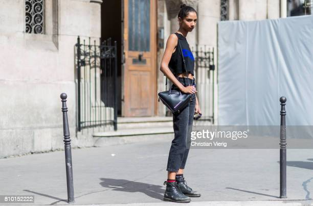 A model wearing Balenciaga bag outside Maison Margiela during Paris Fashion Week Haute Couture Fall/Winter 20172018 Day Four on July 5 2017 in Paris...