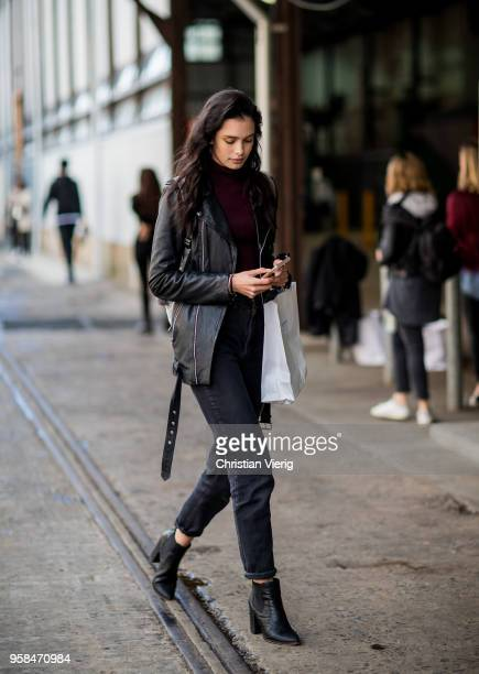 A model wearing black leather jacket cropped denim jeans ankle boots during MercedesBenz Fashion Week Resort 19 Collections at Carriageworks on May...