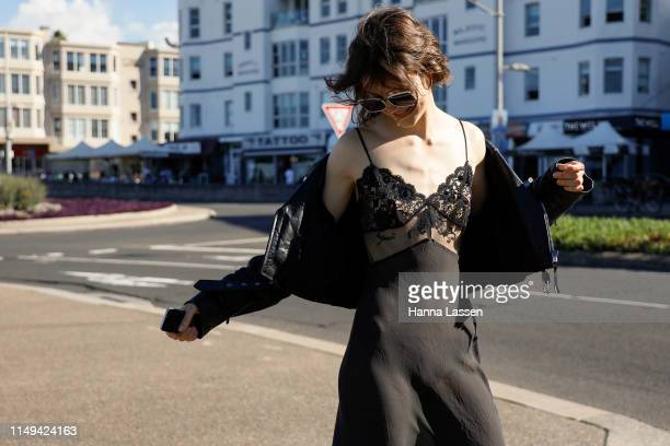 A model wearing black maxi dress and rider jacket at MercedesBenz Fashion Week Resort 20 Collections on May 16 2019 in Sydney Australia