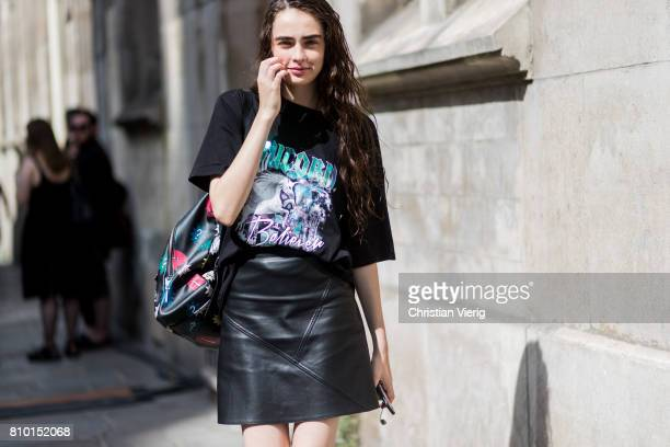 A model wearing black tshirt and black leather skirt outside Maison Margiela during Paris Fashion Week Haute Couture Fall/Winter 20172018 Day Four on...