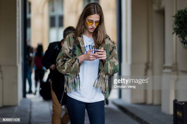 A model wearing camouflage jacket outside Schiaparelli during Paris Fashion Week Haute Couture Fall/Winter 20172018 Day Two on July 3 2017 in Paris...