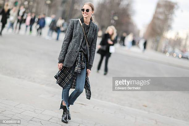 A model wearing Chanel after the Chanel show during Paris Fashion Week Haute Couture Spring Summer 2016 on January 26 2016 in Paris France