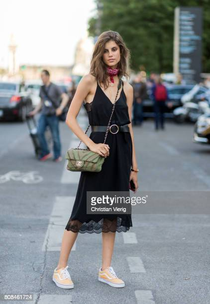 A model wearing Chanel bag black dress bandana outside Alexandre Vauthier during Paris Fashion Week Haute Couture Fall/Winter 20172018 Day Three on...