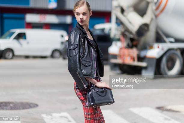 A model wearing checked pants black leather jacket seen in the streets of Manhattan outside Delpozo during New York Fashion Week on September 13 2017...