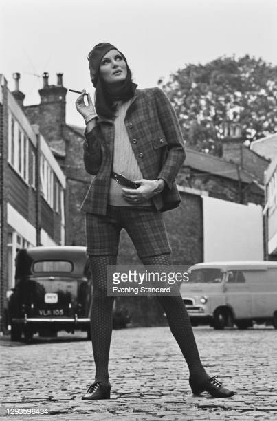 Model wearing checked shorts or culottes with a matching jacket and beret, UK, 25th September 1967.