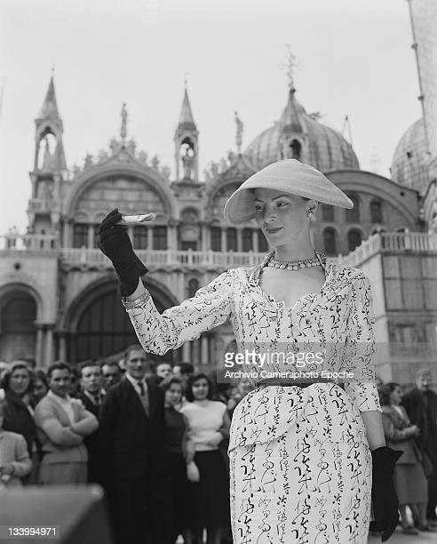 A model wearing Christian Dior fashions in front of St Mark's Basilica in Venice 3rd June 1951