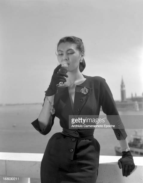 A model wearing Christian Dior fashions near the Piazza San Marco in Venice 3rd June 1951 The island of San Giorgio Maggiore is visible in the...