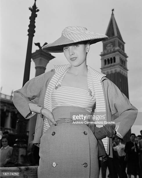 A model wearing Christian Dior fashions on the Piazza San Marco in Venice 3rd June 1951 St Mark's Campanile and the column bearing a winged lion are...
