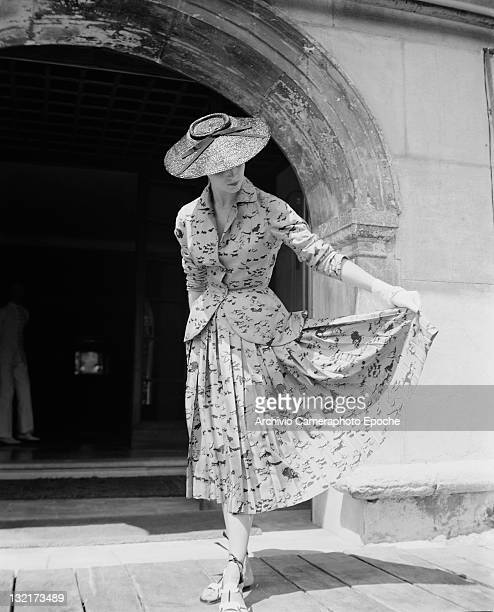 A model wearing Christian Dior fashions outside the Gritti Palace hotel in Venice 3rd June 1951