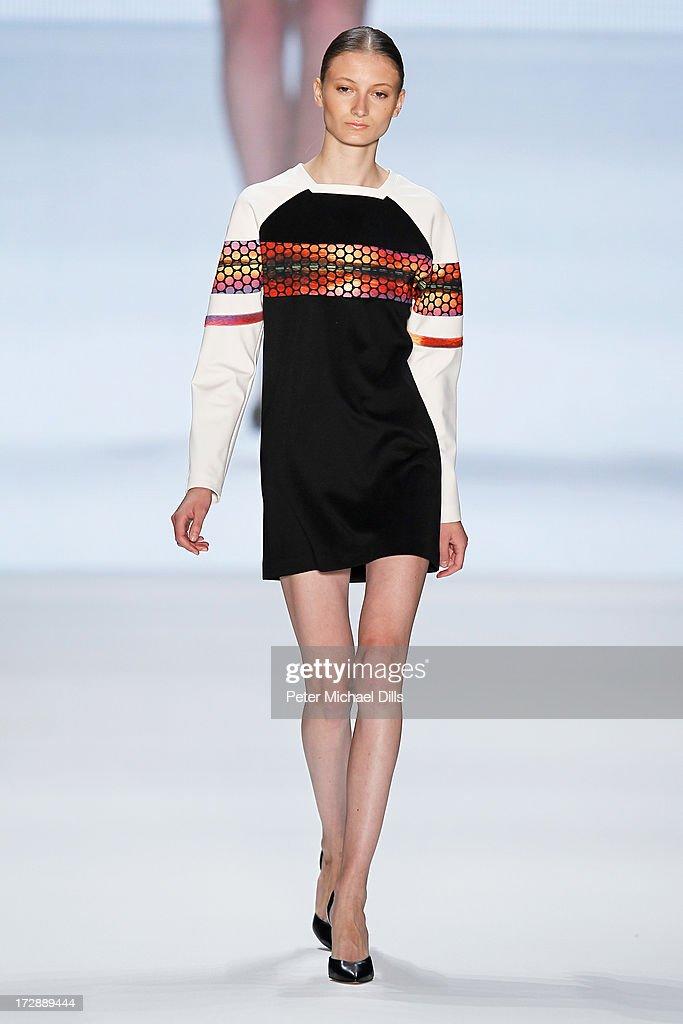 A model wearing clothes designed by Ece Goezen walks the runway at the Ece Goezen, Nazli Bozdag, Nevra Karaca No. 7 Show during Mercedes-Benz Fashion Week Spring/Summer 2014 at Brandenburg Gate on July 5, 2013 in Berlin, Germany.
