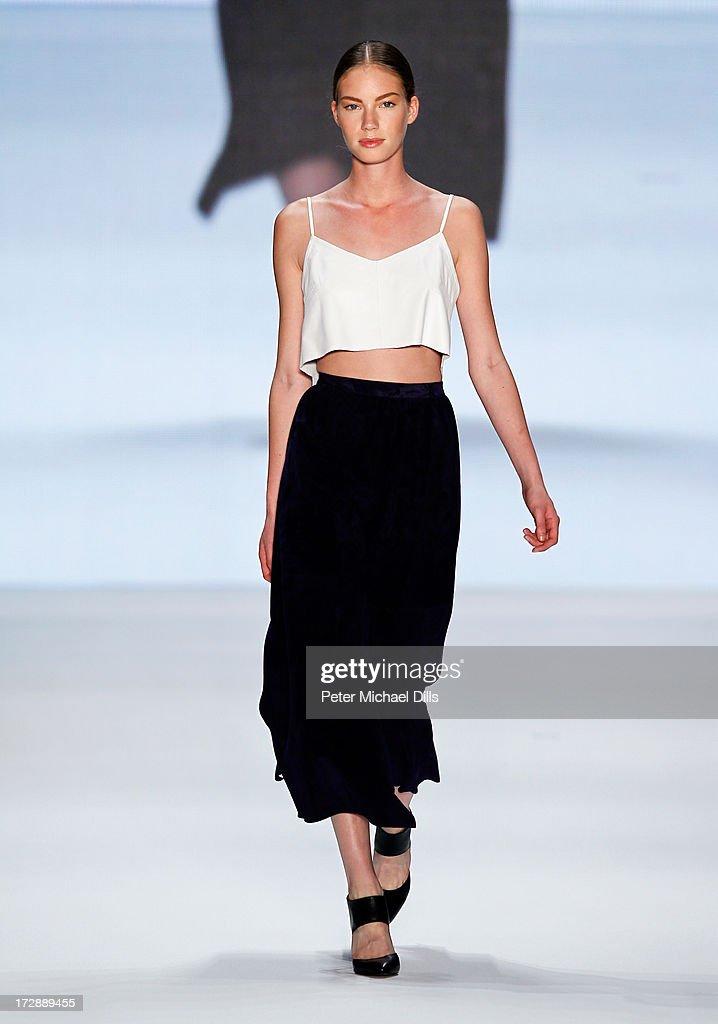 A model (detail) wearing clothes designed by Nazli Bozdag walks the runway at the Ece Goezen, Nazli Bozdag, Nevra Karaca No. 7 Show during Mercedes-Benz Fashion Week Spring/Summer 2014 at Brandenburg Gate on July 5, 2013 in Berlin, Germany.