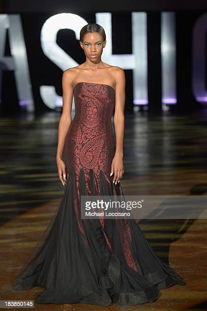 Model wearing David Tlale walks the runway during the 3rd Annual United Colors Of Fashion Gala at Lexington Avenue Armory on October 9, 2013 in New...