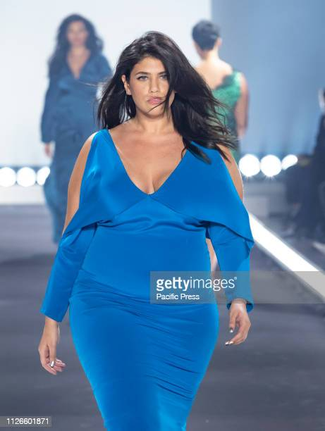Model wearing dress by Cushnie walks runway for 11 Honore fashion show during Fall/Winter New York Fashion Week at Spring Studios.