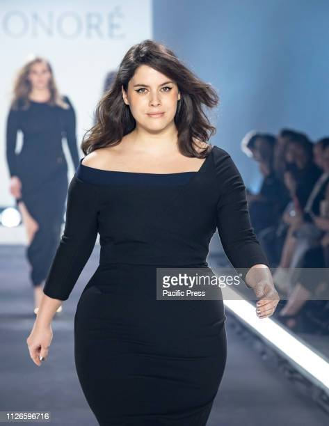 Model wearing dress by Roland Mouret Haney walks runway for 11 Honore fashion show during Fall/Winter New York Fashion Week at Spring Studios.