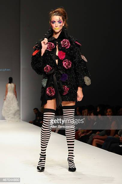 A model wearing fashion by designer Coco Johnsen walks the runway during Style Fashion Week LA at The Reef on March 19 2015 in Los Angeles California