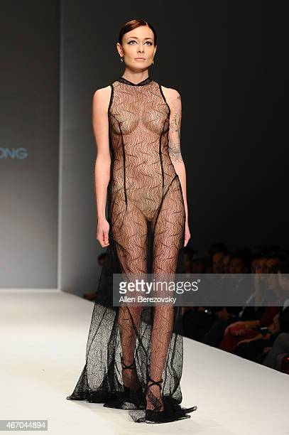 A model wearing fashion by designer Ophelia Song walks the runway during Style Fashion Week LA on March 19 2015 in Los Angeles California