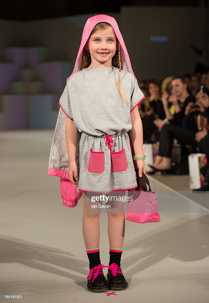 A model wearing Fendi Spring/Summer '13 walks the runway at the Global Kids Fashion Week SS13 public show in aid of Kids Company at The Freemason's Hall on March 20, 2013 in London, England.