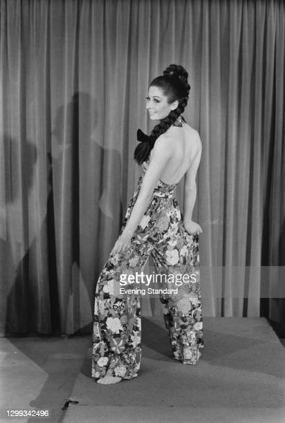 Model wearing halterneck culottes in a floral butterfly pattern, by textile designer Ken Scott, UK, October 1966.