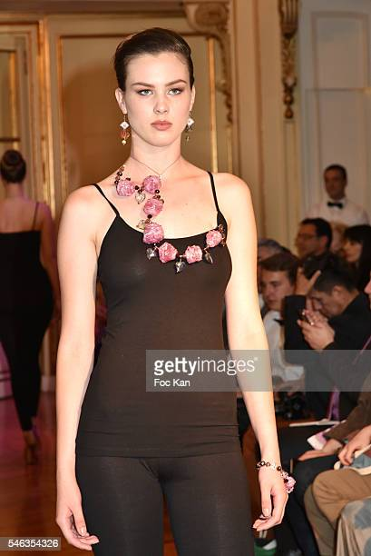 Model wearing jewels designed by Jelena Mandic walks the runway during Serbia Fashion Day at Residence de L'Ambassadeur In PAris on July 11, 2016 in...