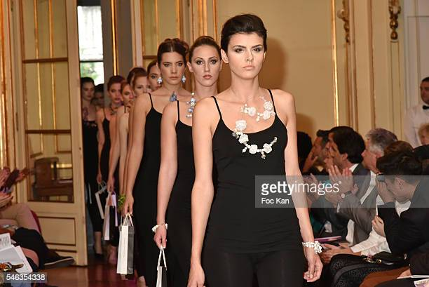 A model wearing jewels designed by Jelena Mandic walks the runway during Serbia Fashion Day at Residence de L'Ambassadeur In PAris on July 11 2016 in...