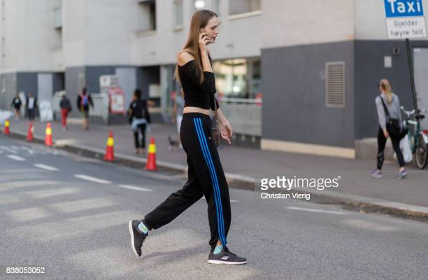 A model wearing jogger pants outside FWSS on August 23 2017 in Oslo Norway