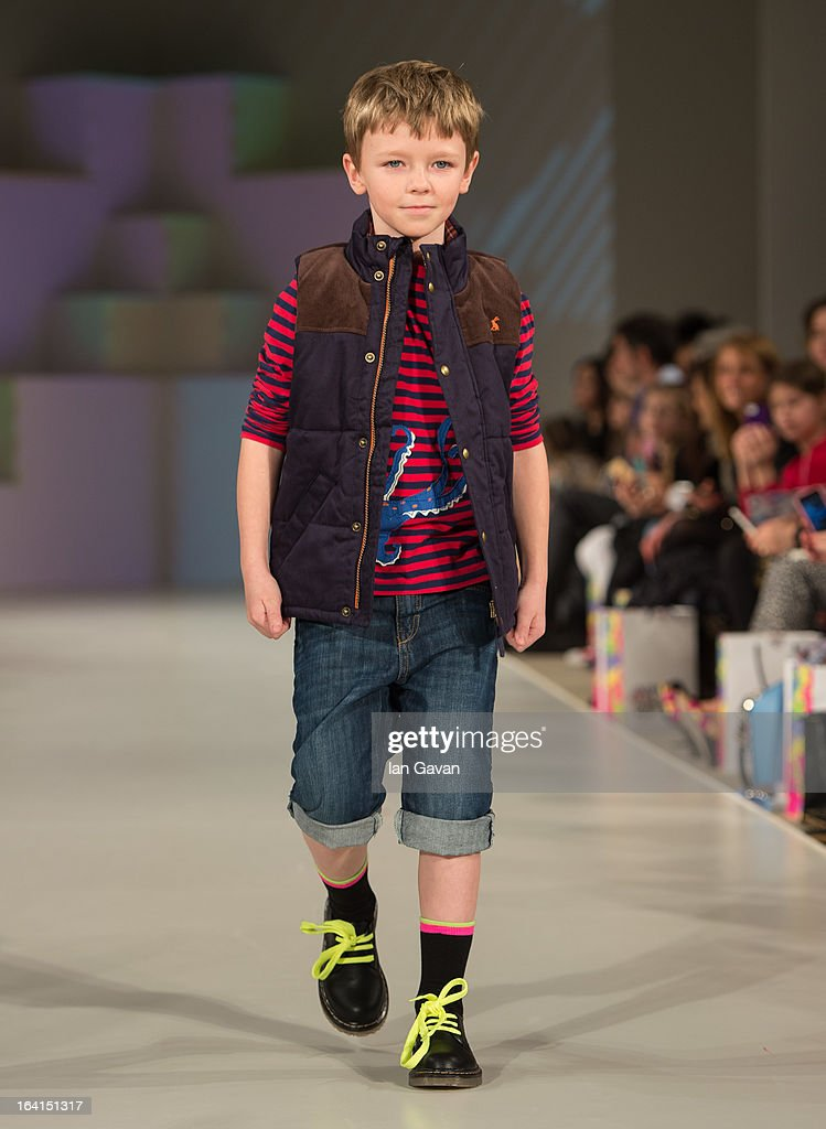A model wearing Joules Spring/Summer '13 walks the runway at the Global Kids Fashion Week SS13 public show in aid of Kids Company at The Freemason's Hall on March 20, 2013 in London, England.