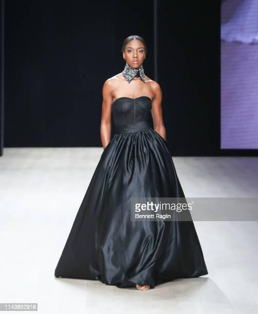 Model wearing Mai Atafo walks the runway during Arise Fashion Week on April 19, 2019 in Lagos, Nigeria.