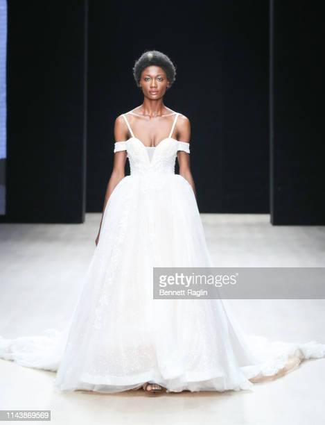 A model wearing Mai Atafo walks the runway during Arise Fashion Week on April 19 2019 in Lagos Nigeria