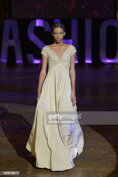 Model wearing Marc Bouwer walks the runway during the 3rd Annual United Colors Of Fashion Gala at Lexington Avenue Armory on October 9, 2013 in New...