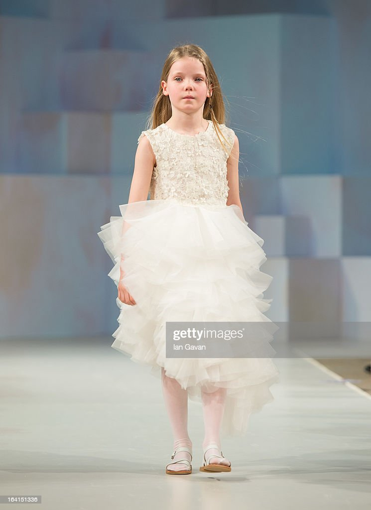 A model wearing Mischka Aoki Spring/Summer '13 walks the runway at the Global Kids Fashion Week SS13 public show in aid of Kids Company at The Freemason's Hall on March 20, 2013 in London, England.