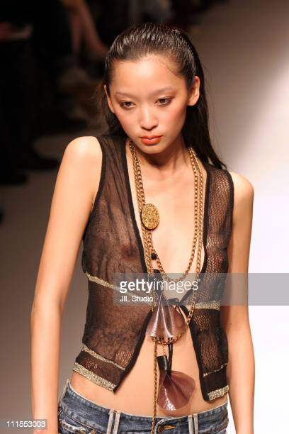 Model wearing MODE ACOTE Spring/Summer 2006 during Tokyo Fashion Week Spring/Summer 2006 MODE ACOTE Runway at Meiji Jingu Memorial Picture Gallery in...